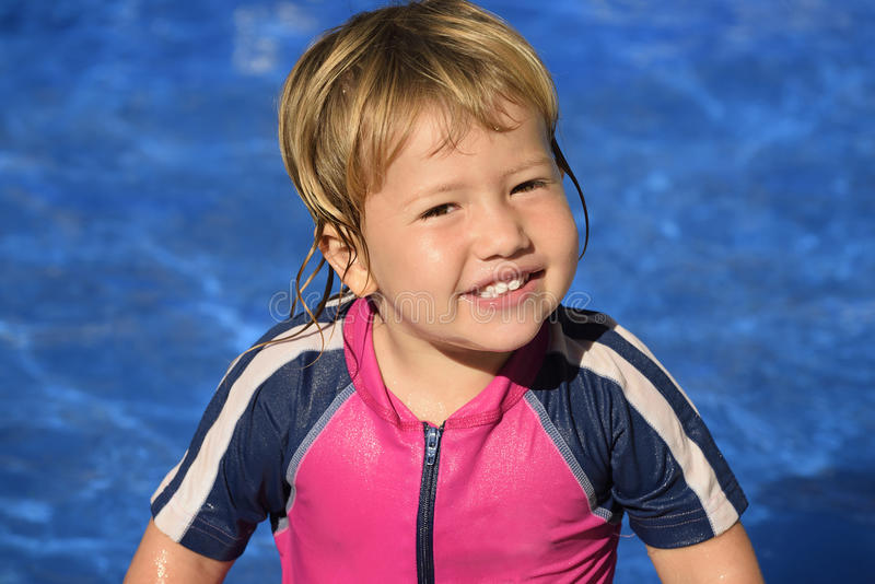 Happy kid in the swimming pool stock photos