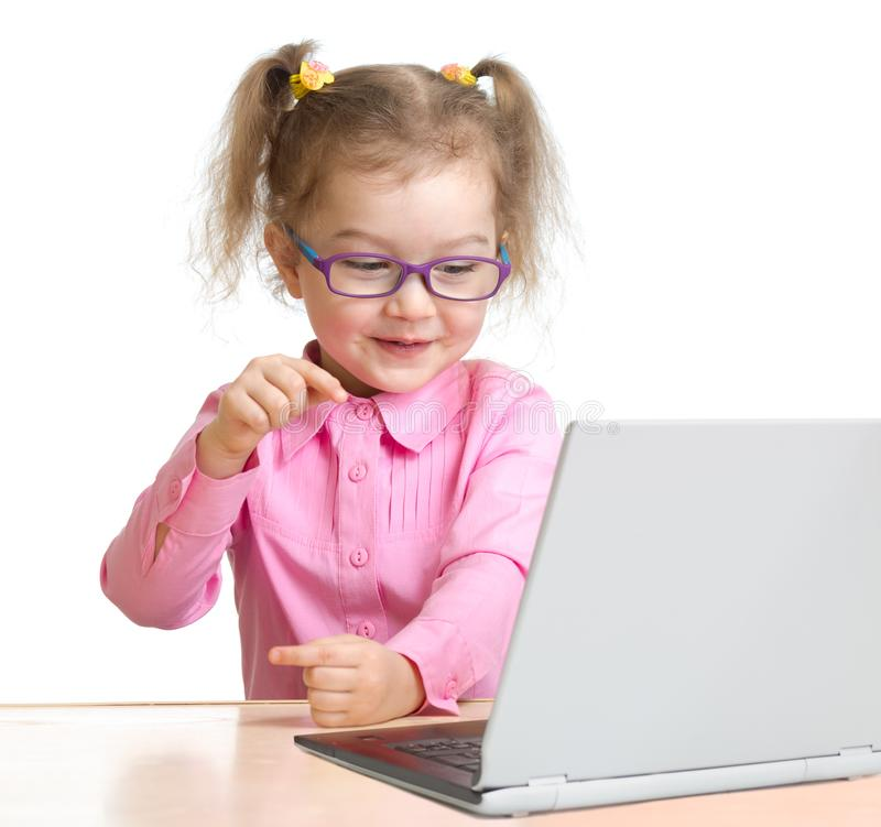 Happy kid in using notebook with great interest  royalty free stock photography