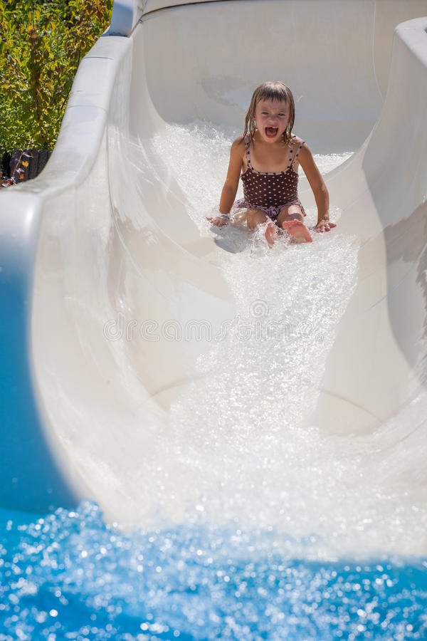 Happy kid in the water park royalty free stock photos