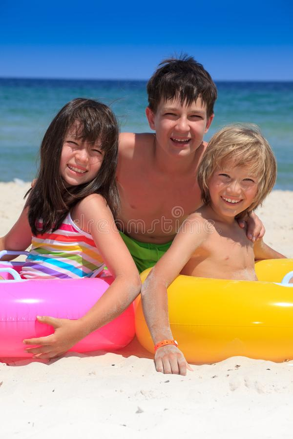 Happy kids on beach royalty free stock photo