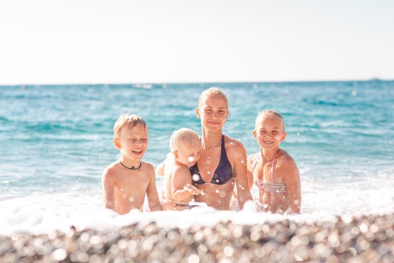 Happy kids on the beach having fun stock images
