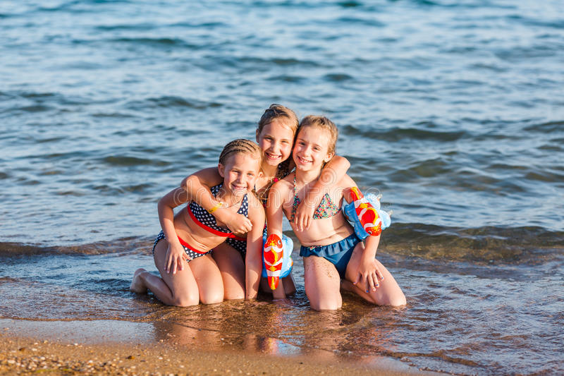 Happy kids on the beach royalty free stock images