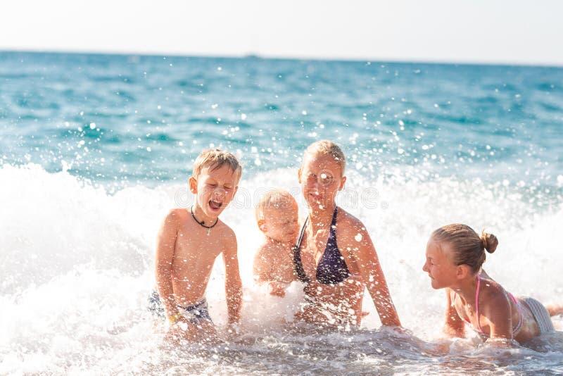 Happy kids on the beach having fun stock photography