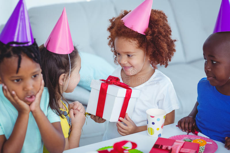 Happy kids at a birthday party. About to open presents royalty free stock images