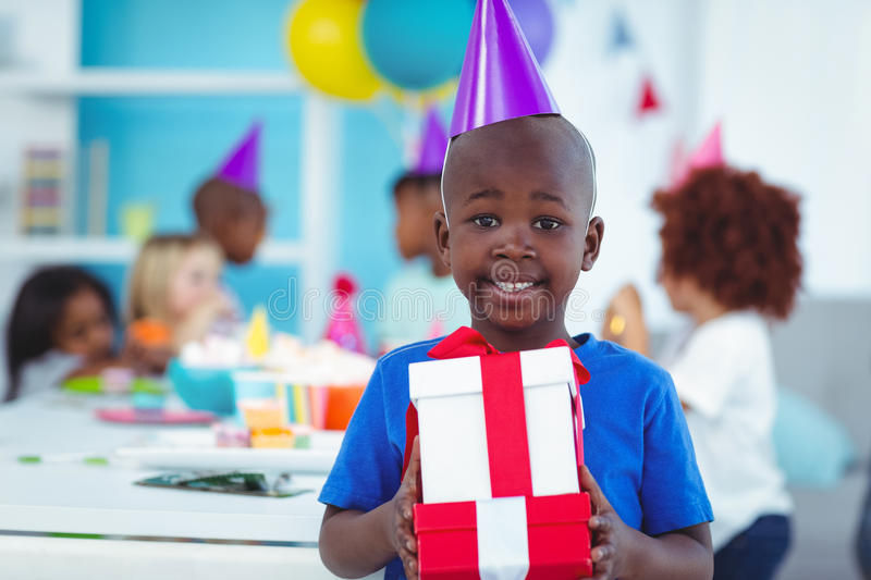 Happy kids at a birthday party stock photo