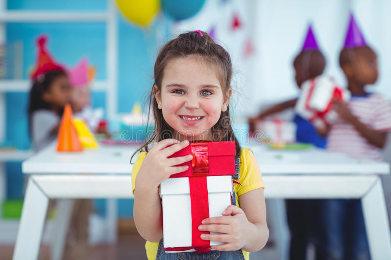 Happy kids at a birthday party. About to open presents royalty free stock image