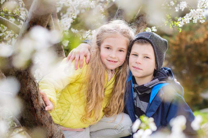 Happy kids boy and girl standing hugging and smiling royalty free stock photo