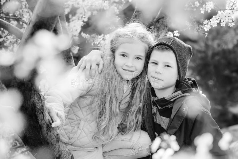 Happy kids boy and girl standing hugging and smiling stock images
