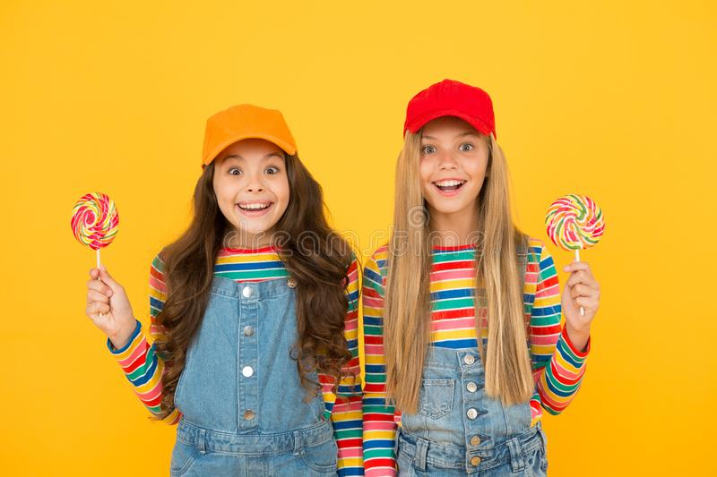 Happy kids. Calories and nutritional value. Sugar free treats. Happy childrens day. Holiday celebration. Happy girls. Hold lollipop candy. Join celebration royalty free stock photo