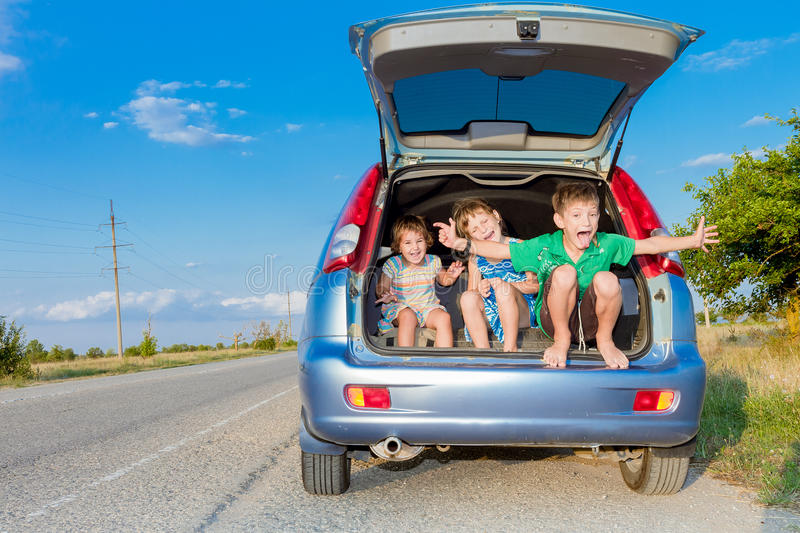 Happy kids in car, family trip, summer vacation travel. Three happy kids in car, family trip, summer vacation travel stock photos