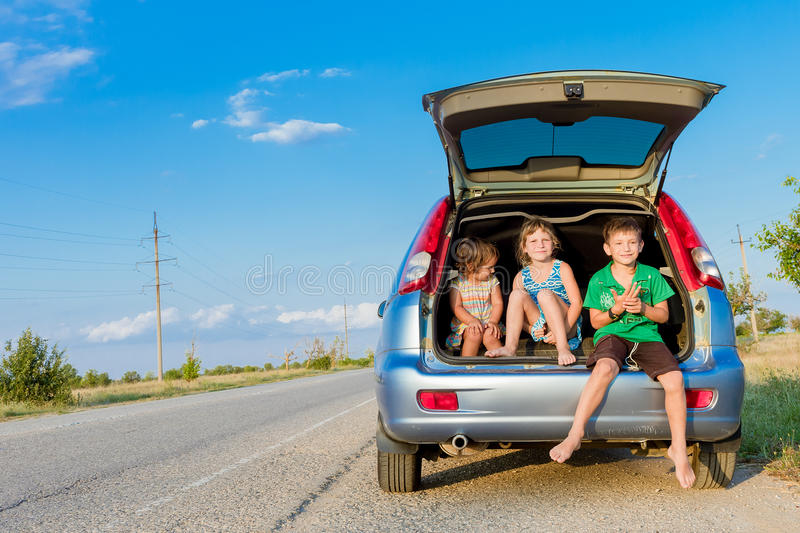 Happy kids in car, family trip, summer vacation travel. Three happy kids in car, family trip, summer vacation travel royalty free stock photo