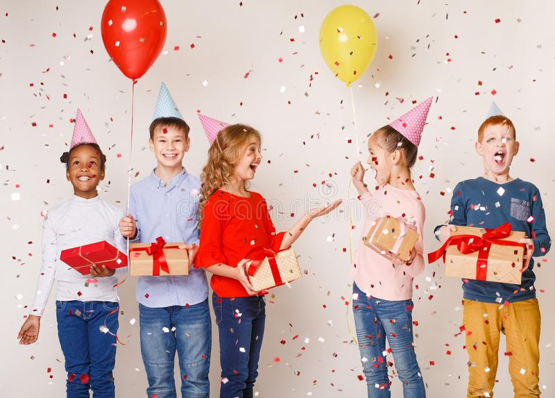 Happy kids celebrating birthday party over background royalty free stock photo