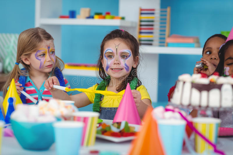 Happy kids celebrating a birthday. Together royalty free stock photo