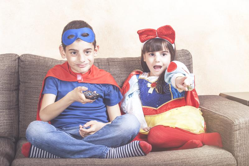 Brother and sister watching movies at home royalty free stock image