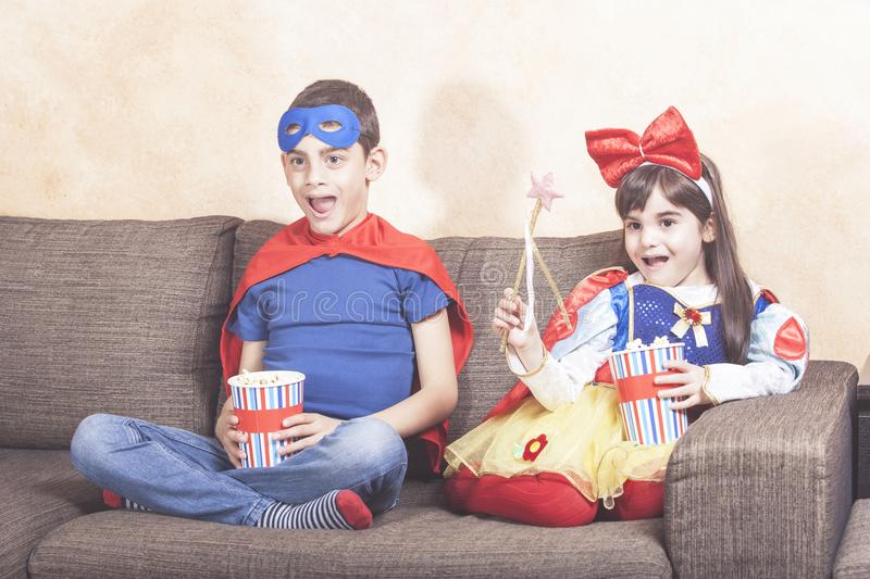 Happy kids watching TV at home stock photos