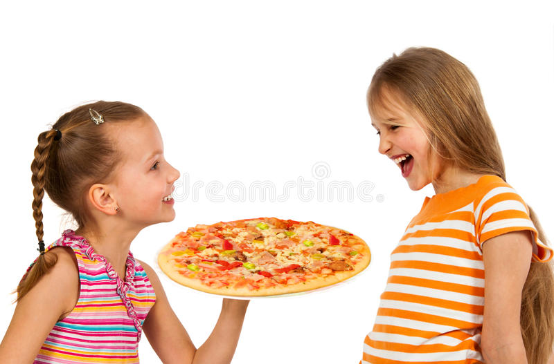 Happy kids eating pizza royalty free stock image