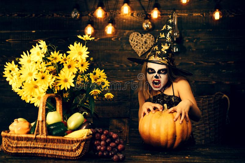 Happy kids on Halloween. Kid eyes with skull make up. Cute little girl child wearing Halloween costumes having fun on royalty free stock images