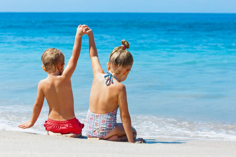 Happy kids have fun in summer camp on beach vacations stock photo