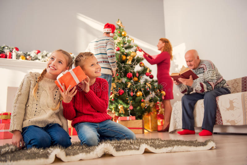 Happy kids having fun with holiday presents royalty free stock photography