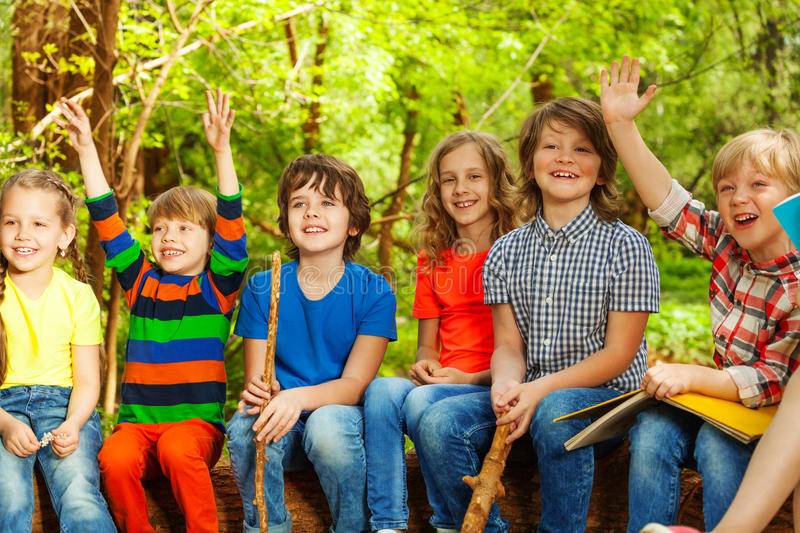 Happy kids having fun in the outdoor summer camp stock image