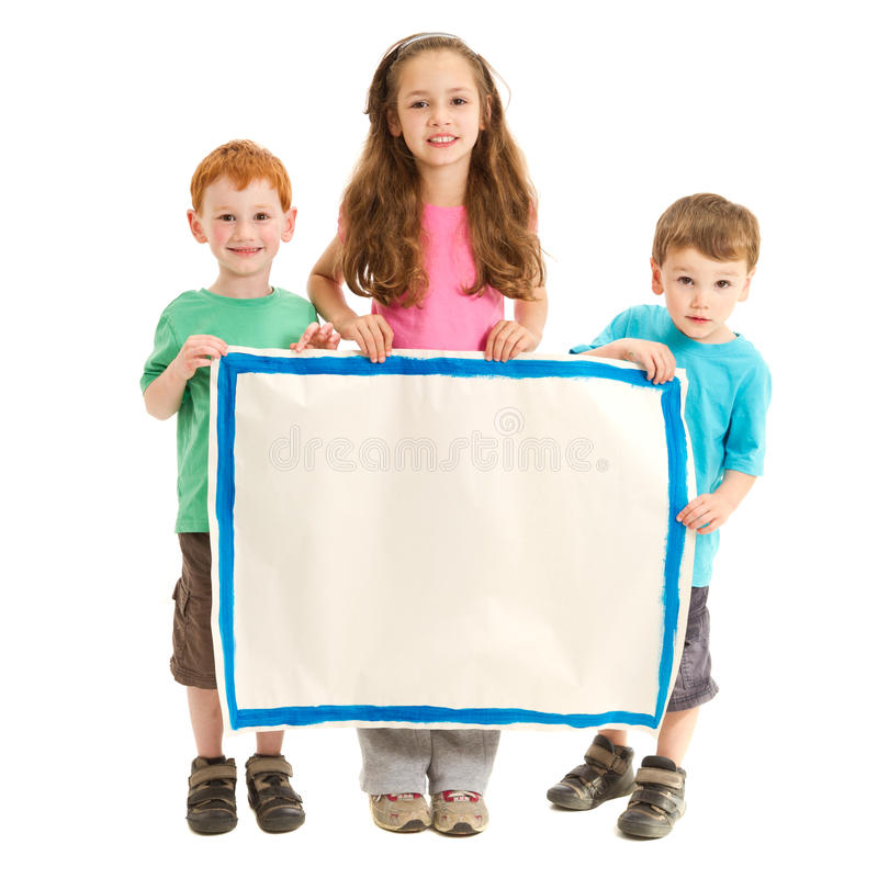 Happy kids holding blank sign royalty free stock image