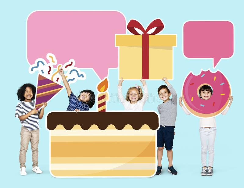 Happy kids with a huge birthday cake stock images