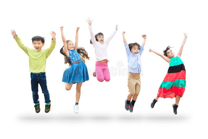 Kids jumping in air over white background. Happy kids jumping in air over white background royalty free stock photo