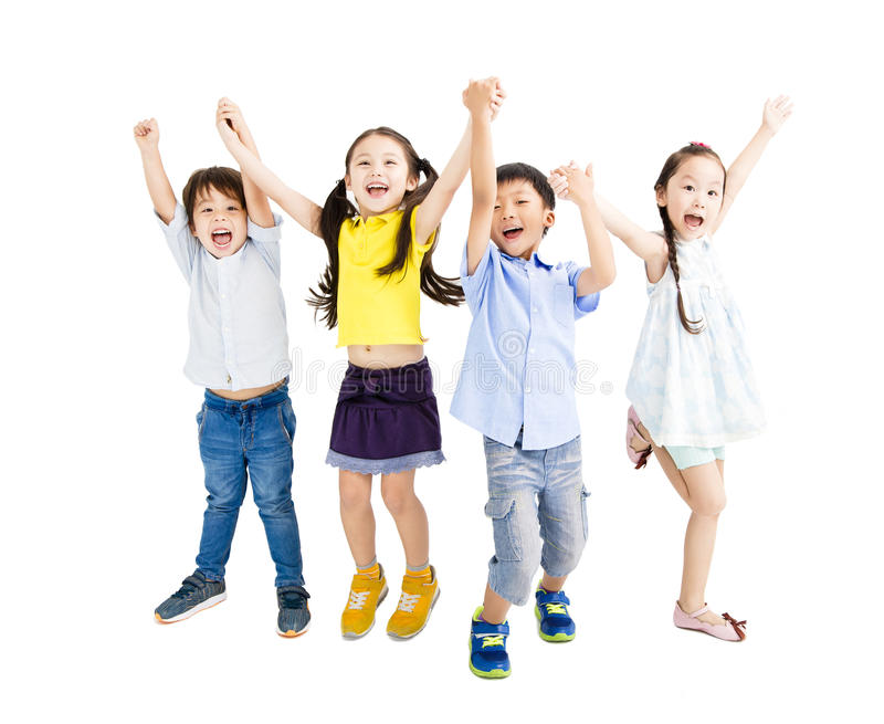 Happy kids jumping and dancing stock photo