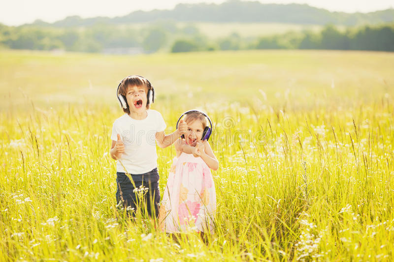 Happy kids listen to music royalty free stock photo