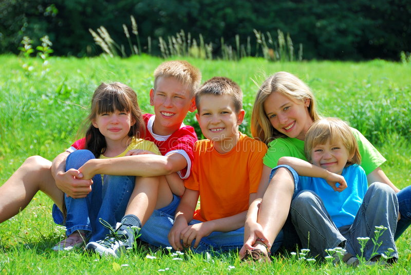 Happy Kids in a Meadow stock images