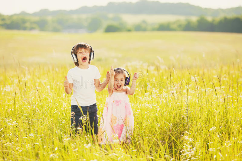 Happy kids on nature stock photography