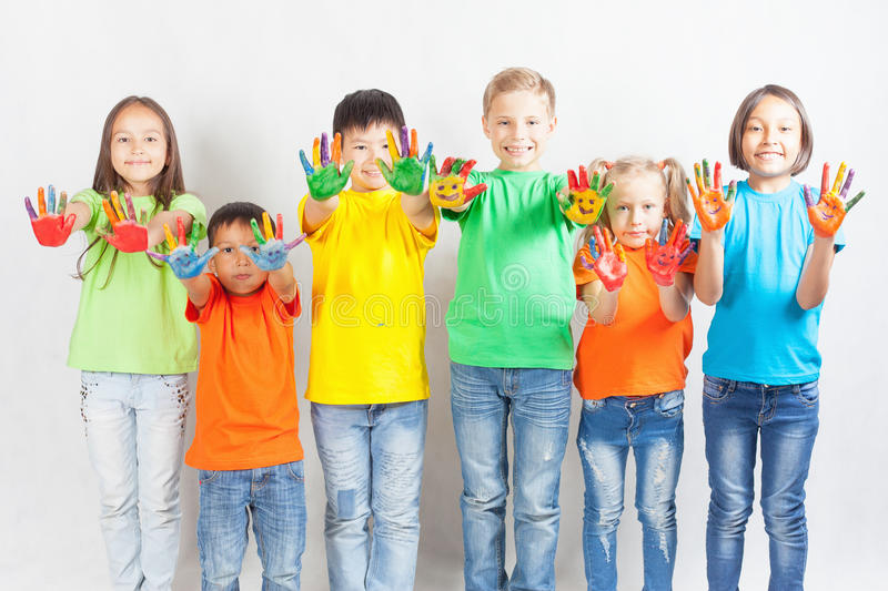 Happy kids with painted hands smiling stock photo