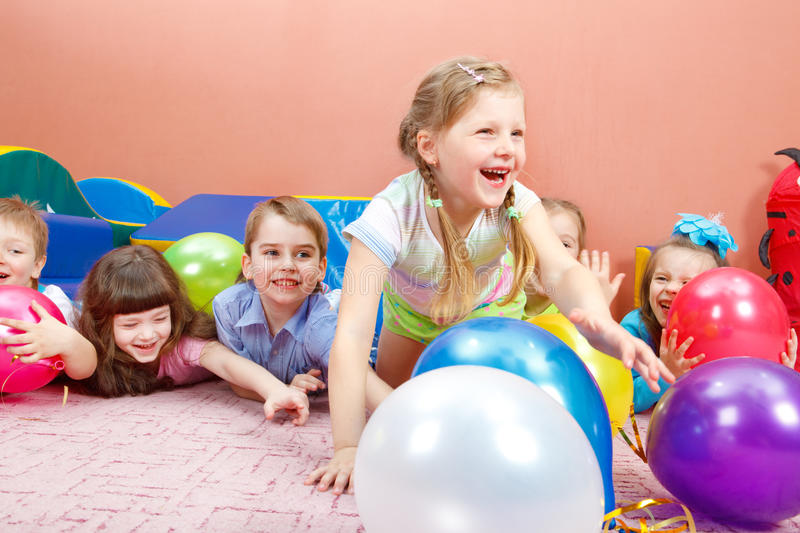 Happy kids playing. A group of happy kids playing with colorful balloons