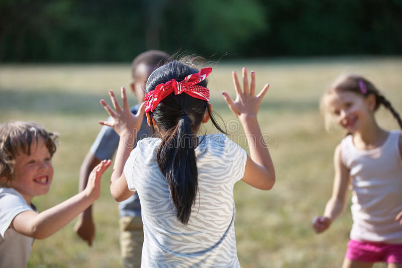 Happy kids playing blind man`s buff royalty free stock images