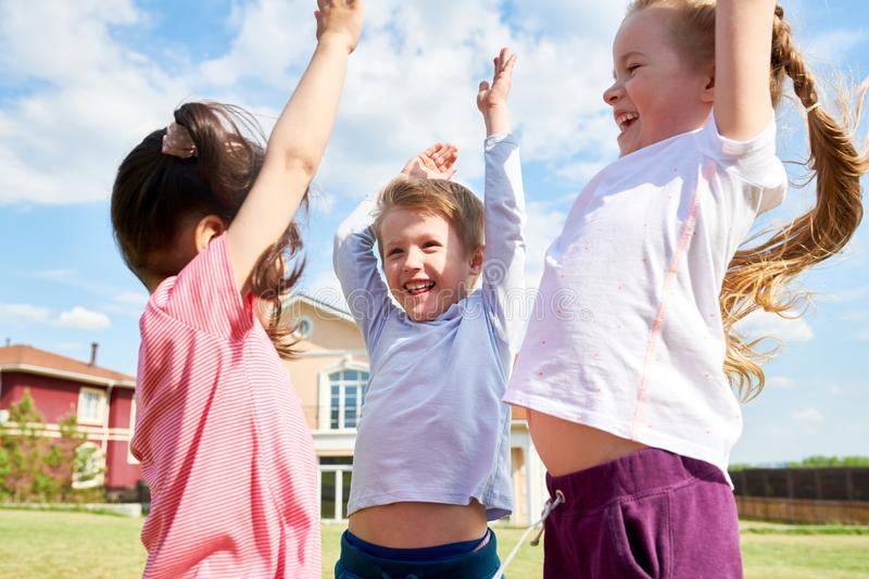 Happy Kids Playing Outdoors royalty free stock images