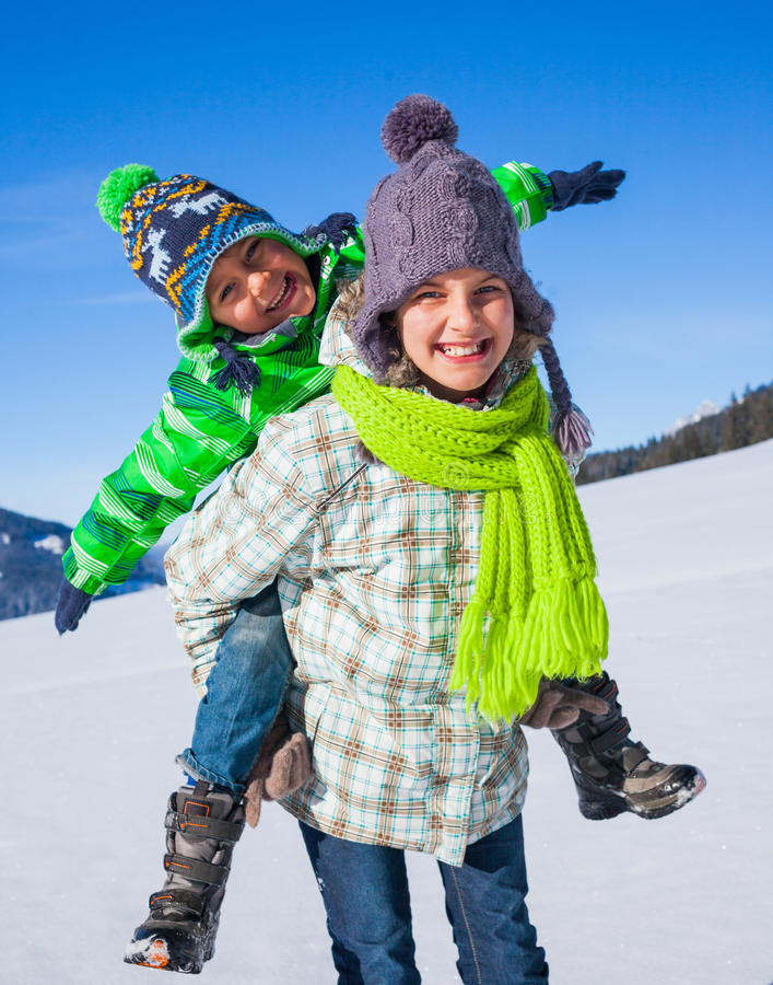 Happy kids playing winter stock images