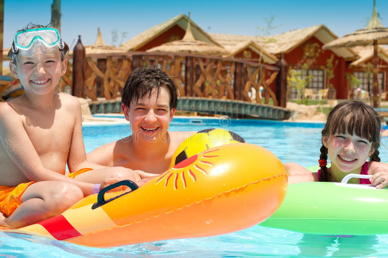 Happy kids in the pool royalty free stock image