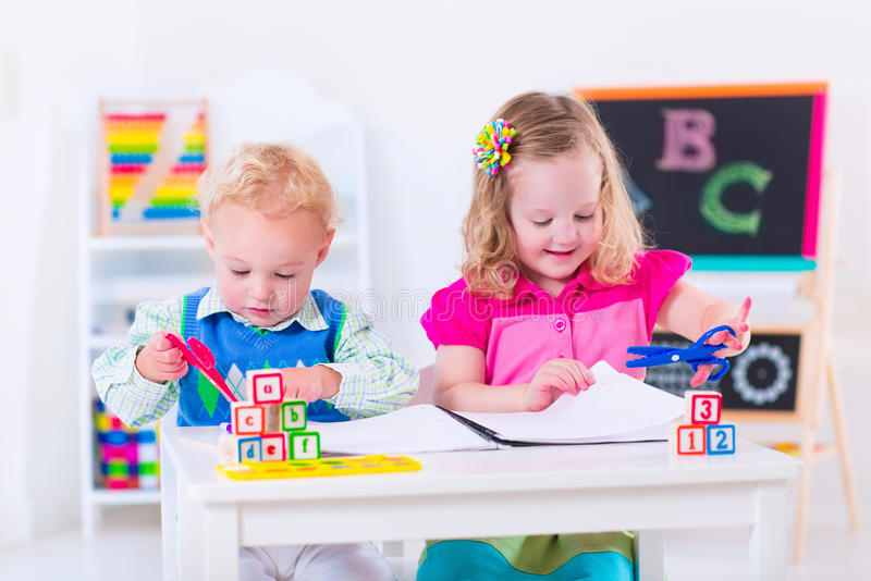 Happy kids at preschool painting stock photo