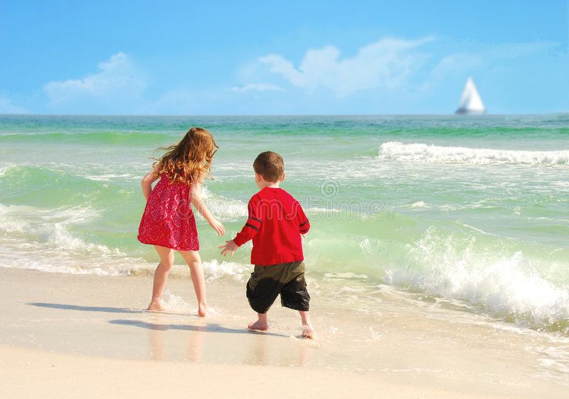 Happy Kids On Pretty Beach Stock Photography
