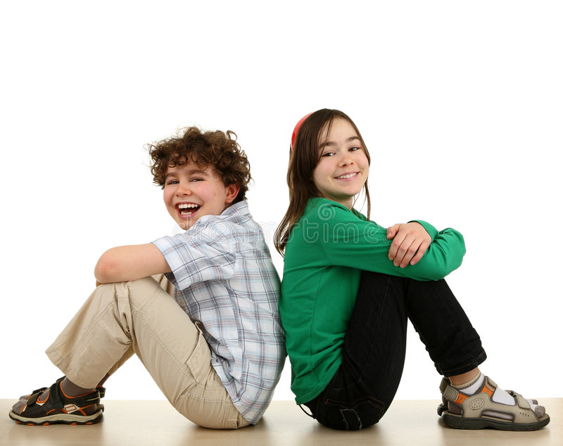 Happy kids sitting stock photography