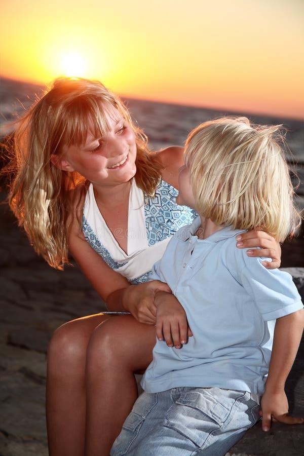 Happy kids at sunset stock photo