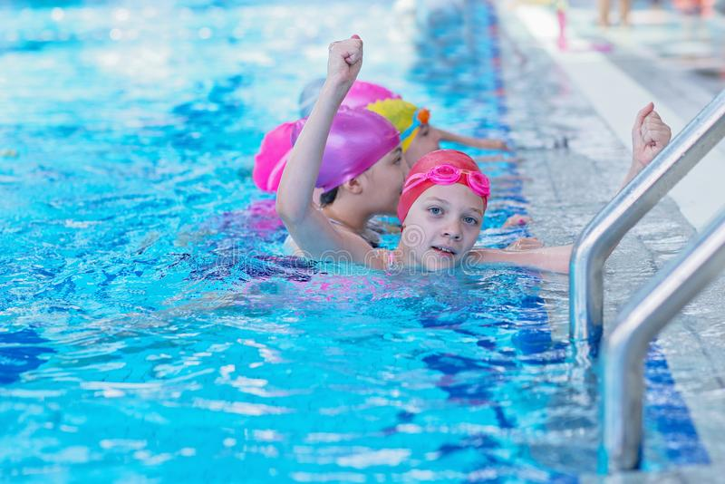 Happy kids at the swimming pool. young and successful swimmers pose. Happy kids at the swimming pool. young and successful swimmers pose stock photo