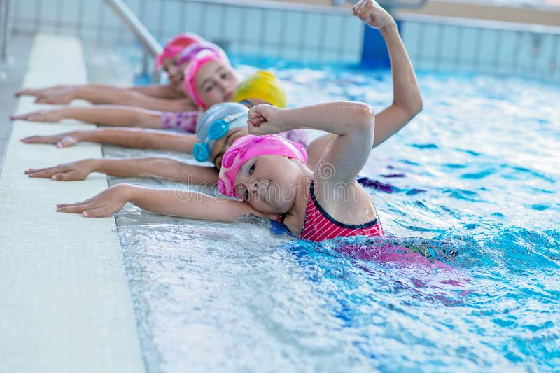 Happy kids at the swimming pool. young and successful swimmers pose. Happy kids at the swimming pool. young and successful swimmers pose stock photography