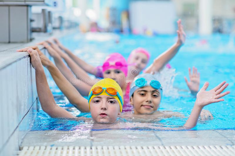 Happy kids at the swimming pool. young and successful swimmers pose. Happy kids at the swimming pool. young and successful swimmers pose royalty free stock image