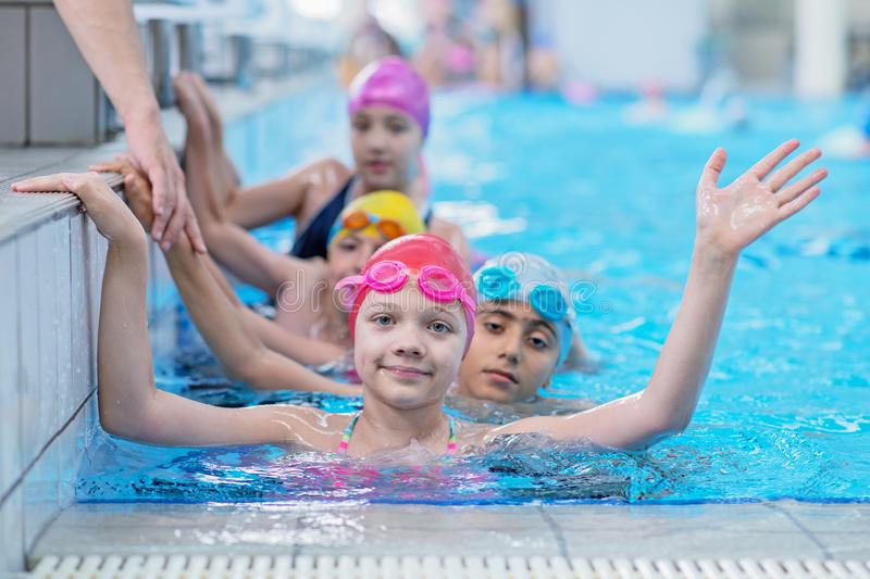 Happy kids at the swimming pool. young and successful swimmers pose. Happy kids at the swimming pool. young and successful swimmers pose stock photos