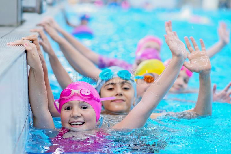 Happy kids at the swimming pool. young and successful swimmers pose. Happy kids at the swimming pool. young and successful swimmers pose royalty free stock photography