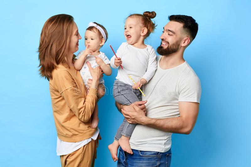 Happy kids and their bearded daddy listening to their mother royalty free stock photo