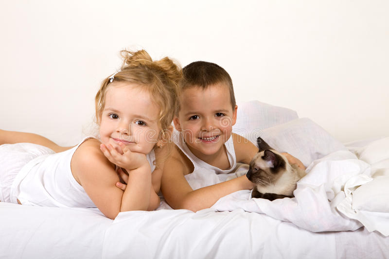 Happy kids with their kitten stock image