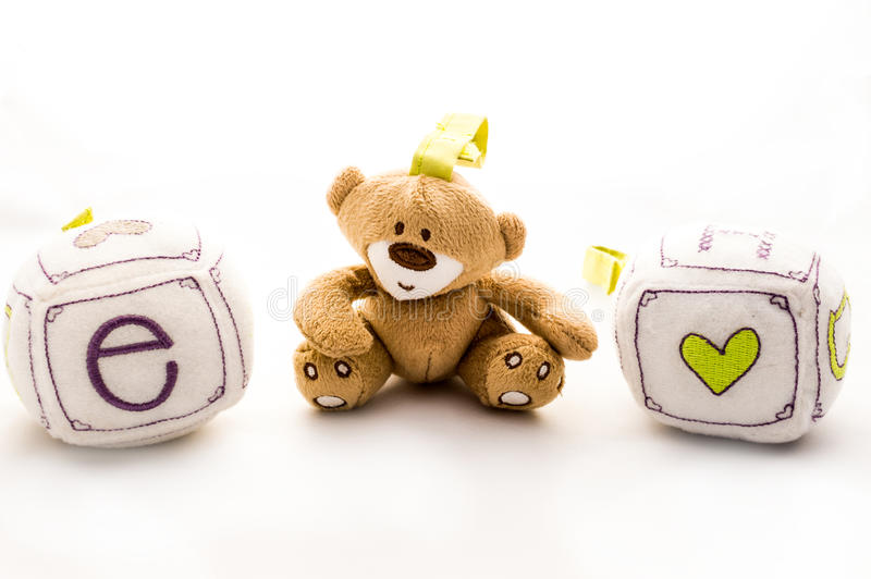 Happy kids toys. Children with toys learn how to develop interpersonal relationships with other kids and adults. They learn the give and take of a good royalty free stock photo