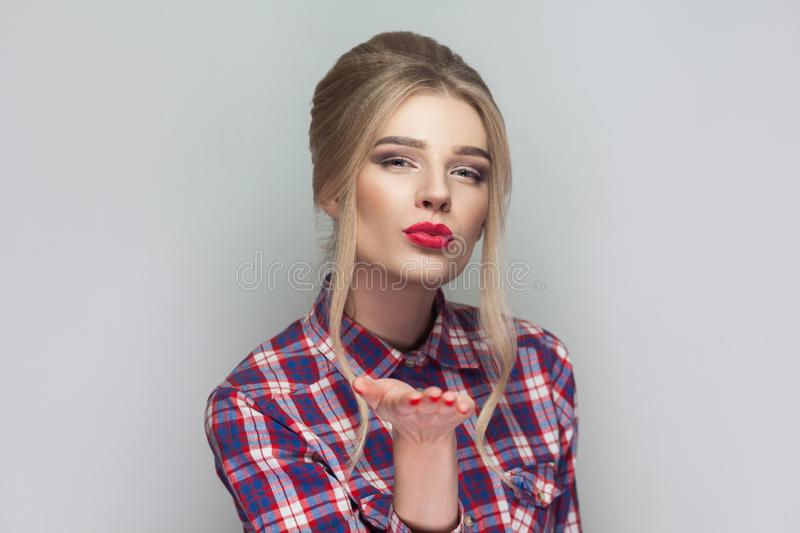 Happy kind blonde beautiful girl with pink checkered shirt, coll stock photography